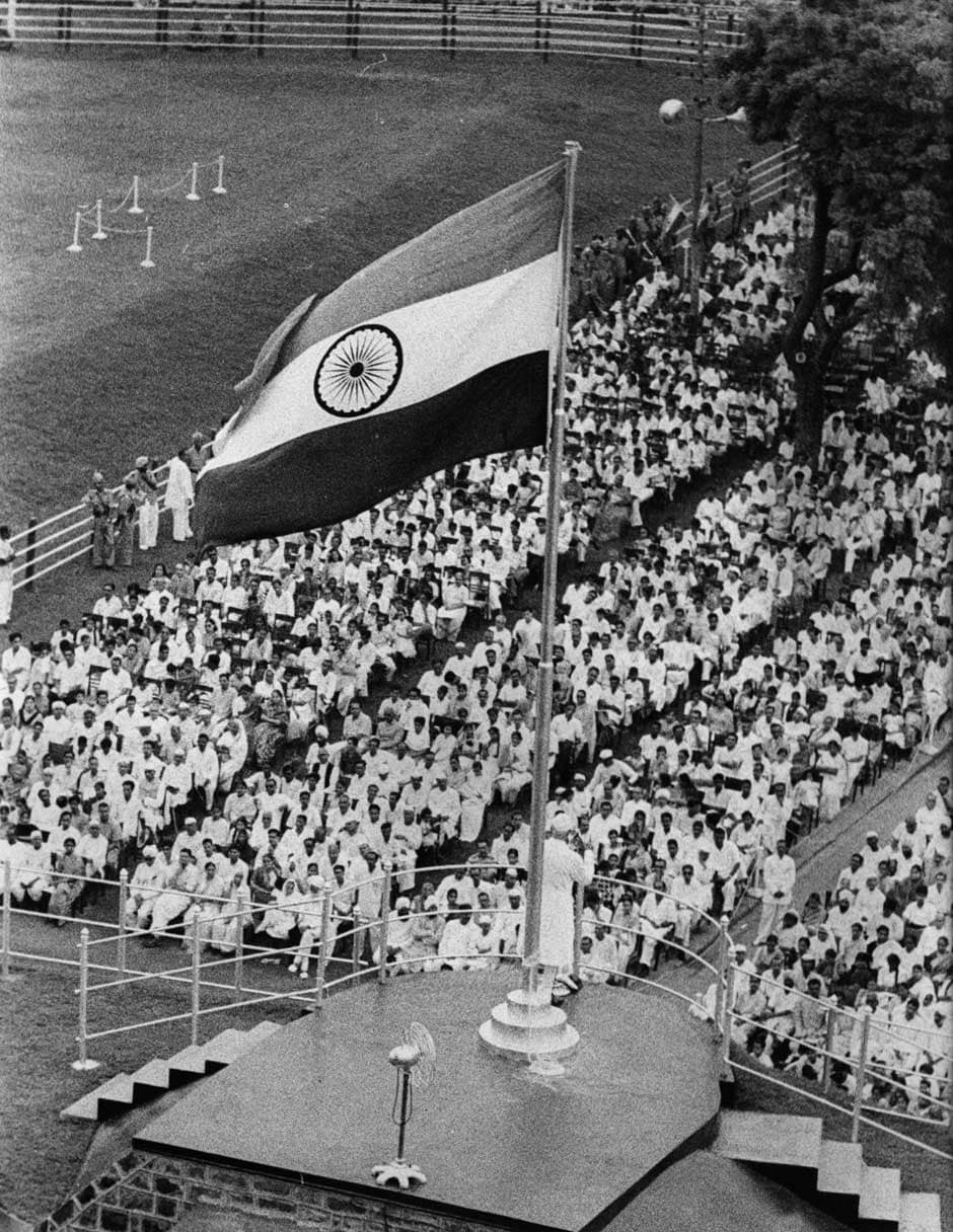 17 August 1960: Indian prime minister Pandit Jawaharlal Nehru (1889-1964) addresses the crowd in Delhi, on the occasion of India's 14th Independence day. Above him flies the national flag of India. Central Press/Getty Images