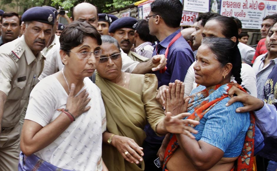Maya Kodnani, BJP MLA and former minister in Gujarat is led by police on her arrival at a special court in Ahmedabad ahead of the sentencing today. AP