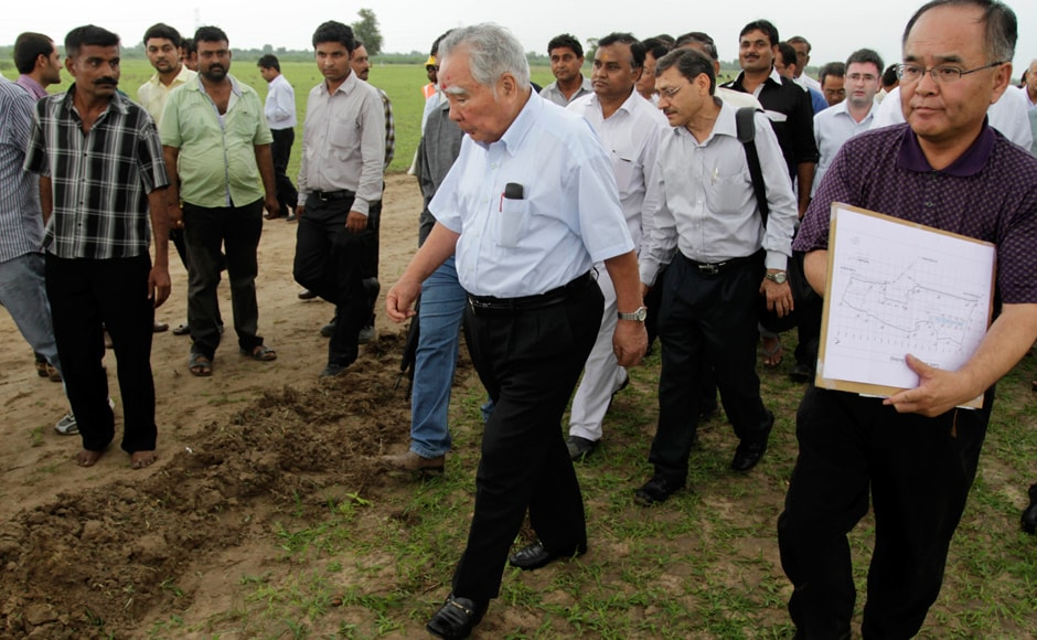 Suzuki, center, inspects the proposed site where the motor company will build a new manufacturing facility in Gujarat by 2015-16. AP