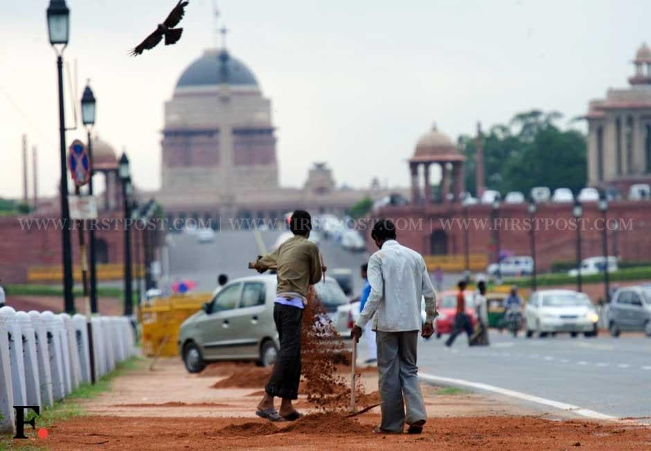 Workers on Rajpath in Delhi ahead of Independence Day. Naresh Sharma/ Firstpost