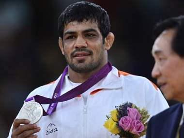 Sushil Kumar with his silver medal. AFP