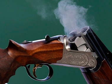 Spent cartridges are ejected from the shotgun of Sweden's Hakan Dahlby during the men's double trap shooting qualification round at the London 2012 Olympic Games at the Royal Artillery Barracks. Reuters
