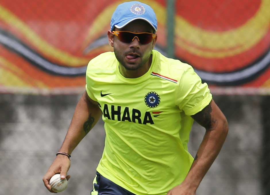 The usually playful Virat Kohli is intense in this photograph as he runs with the ball in his hand. Practicing running run-outs maybe... AP
