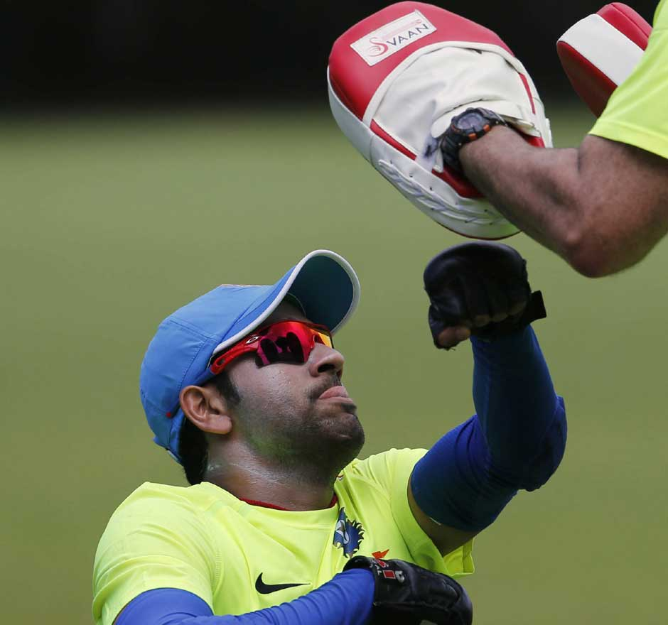 We know Rohit Sharma's a good hitter of the ball... but wonder how well he did at boxing. Here he is undergoing some cross training. AP