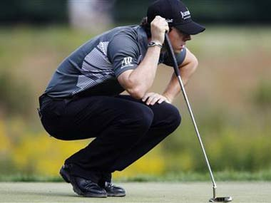 McIlroy leads with Tiger lurking at Deutsche Bank