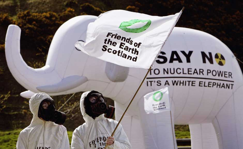 <br />Members of 'Friends of the Earth Scotland', are seen wearing gas masks in front of a inflatable white elephant during a anti nuclear protest at the Scottish Parliament on 26 April 2006 in Edinburgh, Scotland. Jeff J Mitchell/Getty Images