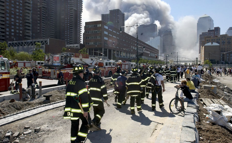 <br />Fireman heading south on the West Side Highway towards the remains of the World Trade Center where smoke continued hours after the colapse. Streets of lower Manhattan with fireman, police, and rescue crews after the colapse of the World Trade Center after being hit by two airplanes on 11 September 2001.  Gabe Palacio/ImageDirect