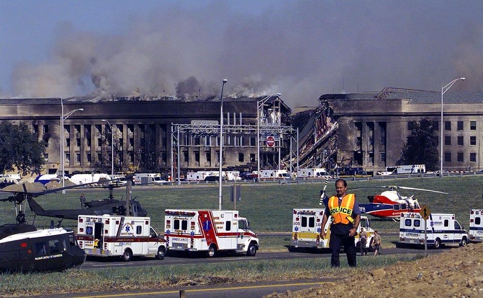 <br />Smoke and flames rise over the Pentagon at about 10am EST on 11 September 2001 following a suspected terrorist crash of a hijacked commercial airliner into the south side of the Pentagon in Arlington. US Navy/Getty Images