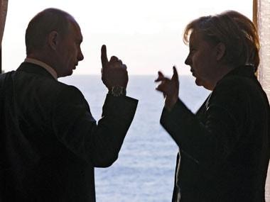 Vladimir Putin and Angela Merkel. AP.
