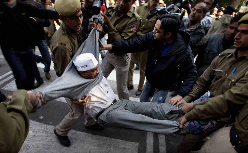 Police drag away AAP leader Arvind Kejriwal from outside Chief Minister Sheila Dikshit's residence during a protest against demolition of houses at Shaheen Bagh, in New Delhi. Vijay Verma/PTI