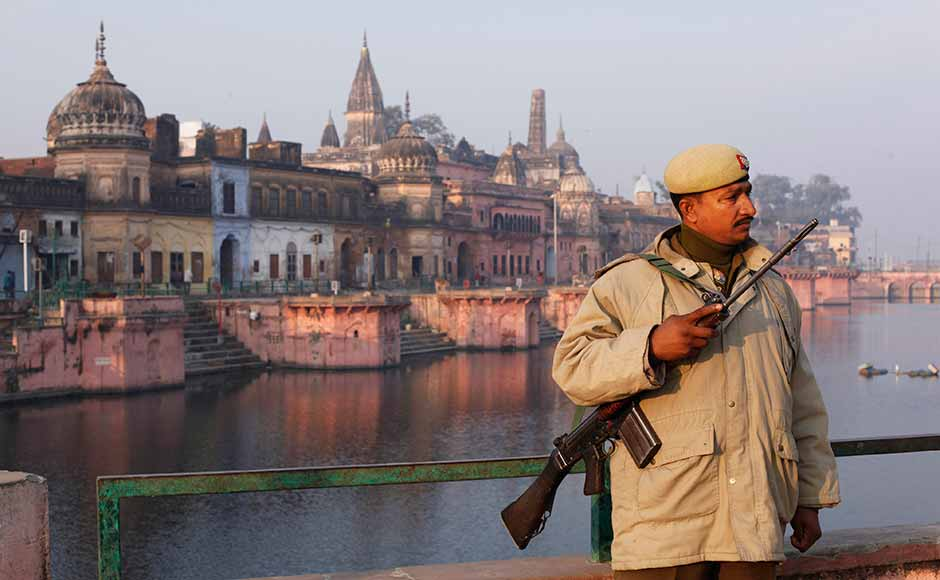 A policeman stands guard near a Hindu temple, on the eve of the anniversary of the Babri mosque demolition in Ayodhya. In 1992, tens of thousands of Hindu extremists destroyed the 16th century Babri mosque at Ayodhya as security forces watched. Hindus say it is the birthplace of their god Rama and contend a temple to him stood on the site before the mosque. Rajesh Kumar Singh/AP
