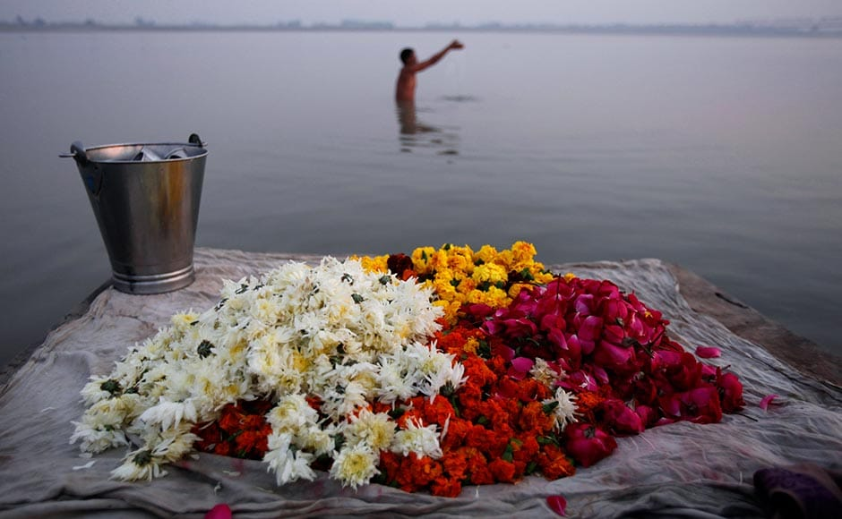 A Hindu man prays after bathing in the Saryu River on the eve of the anniversary of the Babri mosque demolition in Ayodhya. Rajesh Kumar Singh/AP