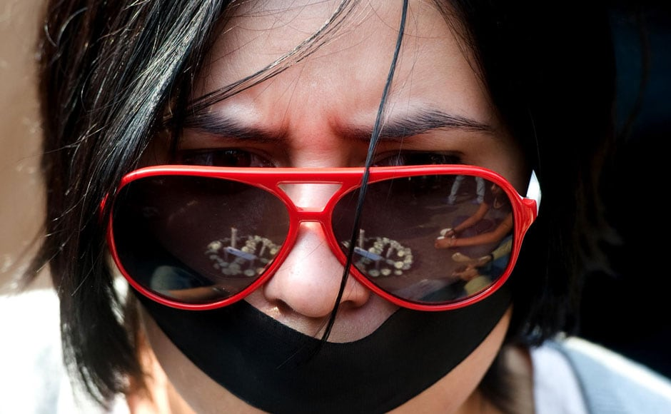 A woman protests against the brutal incident that took the life of the young woman  by tying a black band on her face. Naresh Sharma/ Firstpost