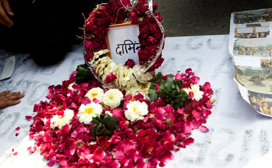 A bed of flowers was erected in the protest site to pay homage to the gangrape survivor's grit and courage. Naresh Sharma/Firstpost
