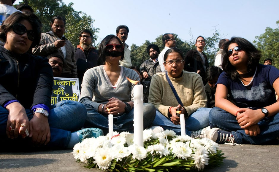 Women wear black bands on their mouth and sit in silent protest near Jantar Mantar. Naresh Sharma/Firstpost