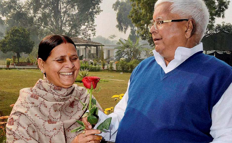 RJD chief Lalu Prasad gets a red rose from his wife Rabri Devi on New Year in Patna PTI
