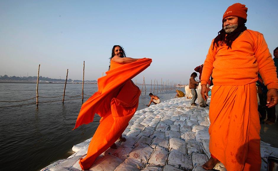 A Sadhu gets dressed after taking a dip at Sangam at Allahabad. Rajesh Kumar Singh/AP