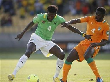 Ivory Coast's Kolo Toure challenges Togo's captain Emmanuel Adebayor during their African Nations Cup (AFCON 2013) Group D soccer match in Rustenburg. Reuters