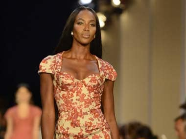 Model Campbell walks down the runway as she presents a creation from the Zac Posen Spring/Summer 2013 collection during New York Fashion Week