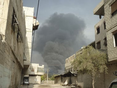 Syrian forces kill more than 100 in Homs