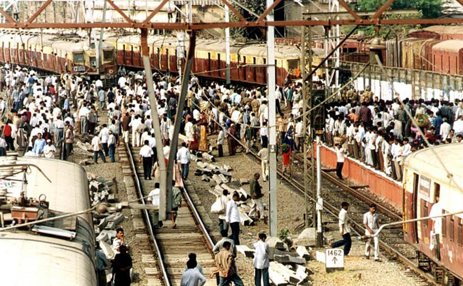 Trade union activists stop trains in central Bombay during a 24 hours strike in Maharashtra 25 April 2001. The strike, affecting the entire industrial heartland of the state of which Bombay is the capital, was enforced by a rare alliance of trade unions and parties across the political spectrum to protest against the federal government's liberal reformist economic policies. AFP