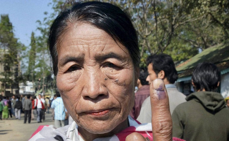 A Naga woman shows her finger marks after casting her vote for the Nagaland assembly election in Dimapur. PTI