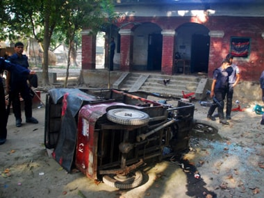 In this photograph taken on March 1, 2013, the wreckage of a three wheeler is seen in front of a Bangladeshi police station in Gaibandha north from Dhaka, where Jamaat-e-Islami activists killed three police personal.