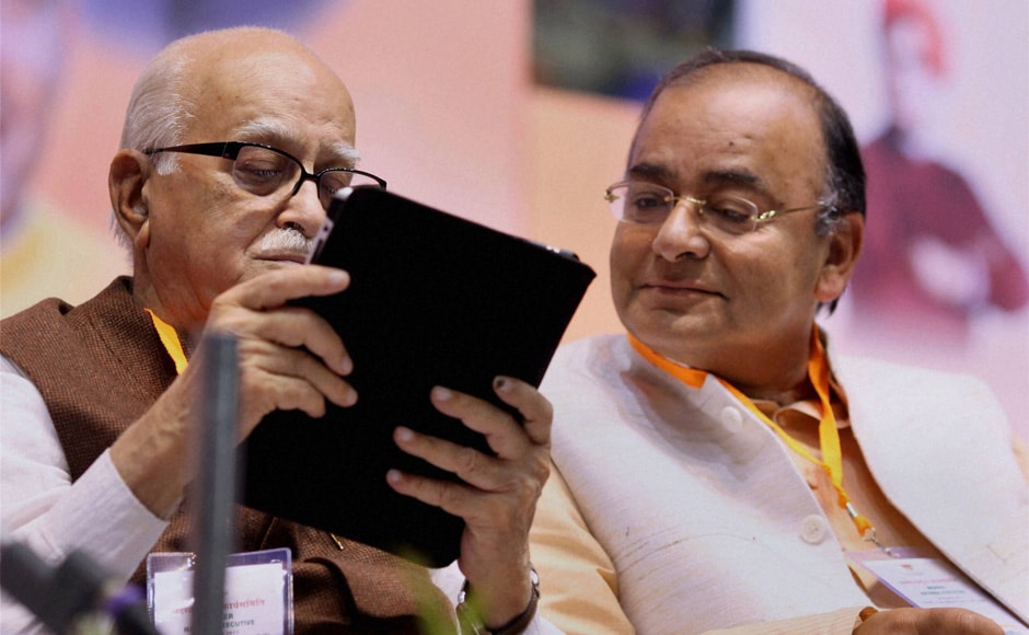Senior BJP leader L K Advani and Arun Jaitley during the last day of the Party National Council Meetinng in New Delhi on Sunday. PTI