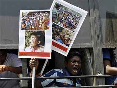 Students shout slogans from inside a bus during a protest in the southern Indian city of Chennai March 18, 2013. Reuters