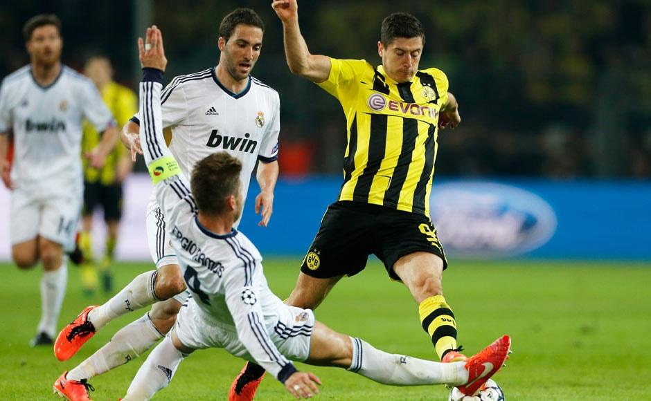 Real Madrid's Sergio Ramos challenges Dortmund's Robert Lewandowski. AP