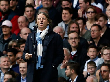 Manchester City's manager Roberto Mancini reacts during their English Premier League soccer match against Tottenham Hotspu at White Hart Lane in London
