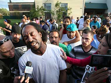 This May 6, 2013 file photo shows neighbour Charles Ramsey speaking to media near the home where missing women Amanda Berry, Gina DeJesus and Michele Knight were rescued in Cleveland. Associated Press.