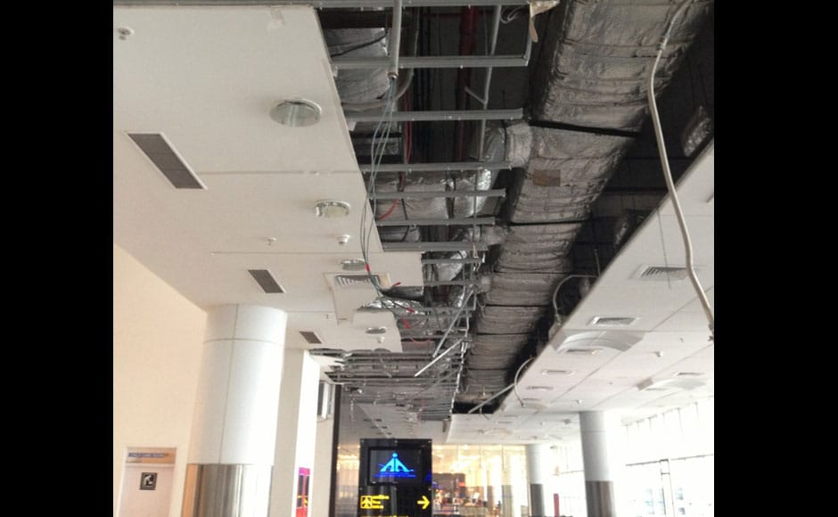 The section of roof that collapsed in the domestic terminal - 40 panels of its false ceiling fell off: Firstpost