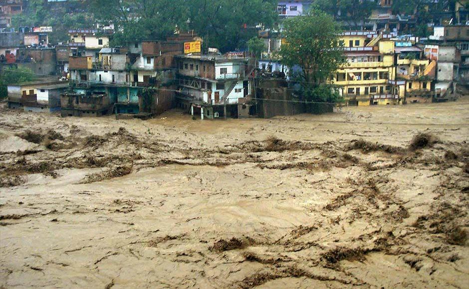 Chamoli: A view of flooded Mandakini river in Chamoli district on Tuesday followed by heavy rains in Uttarakhand. PTI