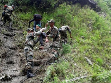 Army jawans rescue a stranded child from the floods. AP