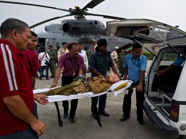 Rescue workers carry an injured victim in Uttarakhand. AFP