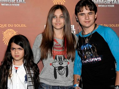 Paris Jackson is pictured here (centre) with her siblings. AP image