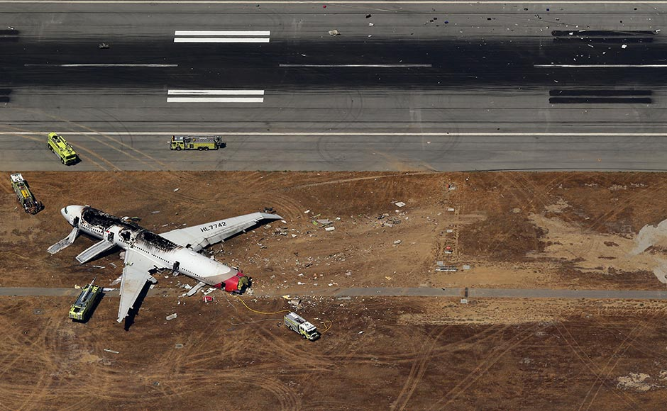 Debris from an Asiana Airlines Boeing 777 plane lies along a runway after it crashed while landing at San Francisco International Airport in California. The plane, with 307 people on board, crashed and burst into flames as it landed at San Francisco International Airport on Saturday after a flight from Seoul. Jed Jacobsohn/Reuters