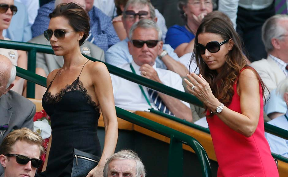 Victoria Beckham (L) and the wife of chef Gordon Ramsay, Tana Ramsay (R), arrive on Centre Court for the final between Andy Murray and Novak Djokovic. Stefan Wermuth/Reuters