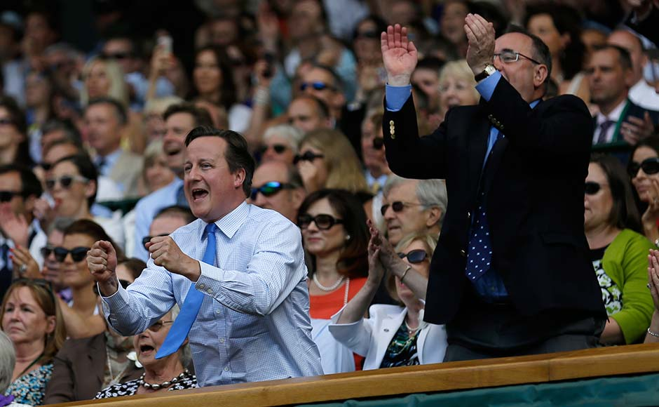 British Prime Minister David Cameron, front left, and Scottish First Minister Alex Salmond, front right, react as Andy Murray plays Novak Djokovic. Associated Press