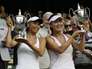 Su-Wei Hsieh of Taiwan, left, and Shuai Peng of China pose with their trophies after winning against Ashleigh Barty of Australia and Casey Dellacqua of Australia. AP