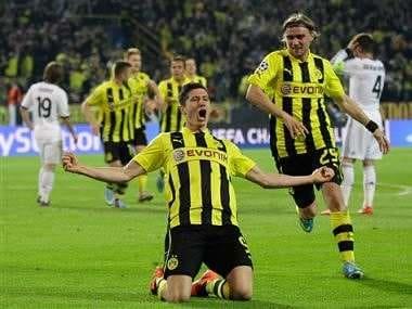 Lewandowski commits to Dortmund after failed Bayern move