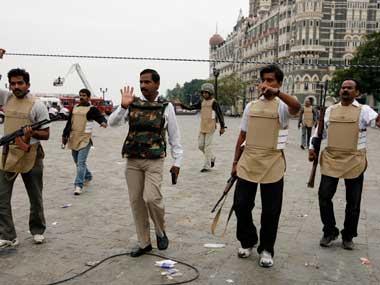 Mumbai police officials outside the Hotel Taj Palace during the November 2008 attacks. Reuters