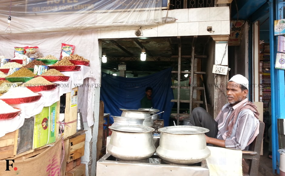 Mohd. Samir, owner Subhanallah Hotel near Jama Masjid in New Delhi says here's what one gets in his hotel -- for Rs. 1, Rs. 5: nothing and for Rs. 12: Three plain chapattis. Arlene Chang/Firstpost.