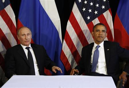 In wishing Bush well, Putin has message for Obama