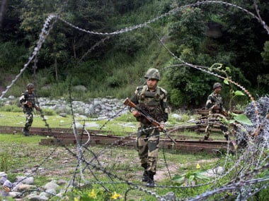 Border Security Force (BSF) jawans patrol near the Line of Control in Poonch. PTI