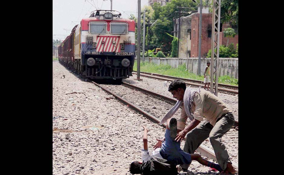 Photo Dramatic Rescue Of Boy On Train Tracks In Allahabad