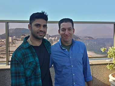 In this undated photo released by Janine Gibson of The Guardian, Guardian journalist Glenn Greenwald, right, and his partner David Miranda are seen together. Associated Press