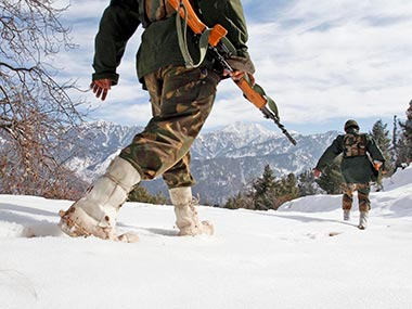 Indian army soldiers patrol near the Line of Control (LOC), that divides Kashmir between India and Pakistan, in Churunda village in this Jan 2013 file photo. Image used for representational purposes only. Associated Press