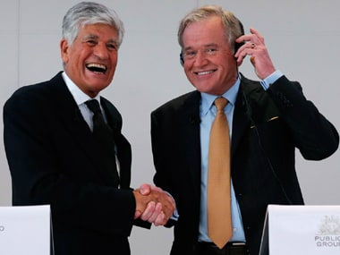 Maurice Levy (Chairman & CEO, Publicis Groupe), John Wren (President & CEO, Omnicom Group) shake hands after the merger.